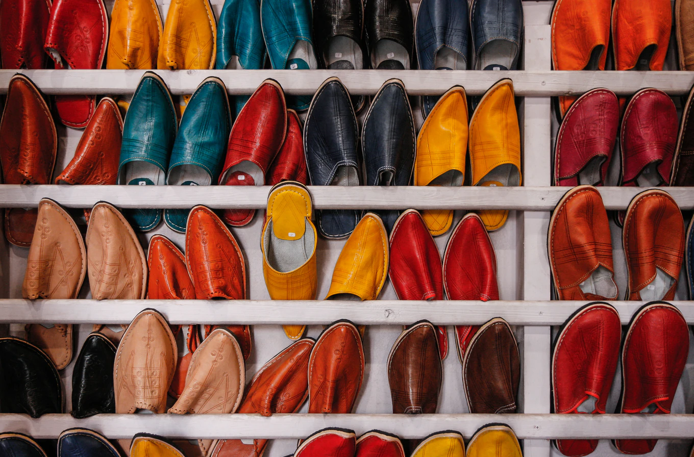 racks full of colorful pointed shoes
