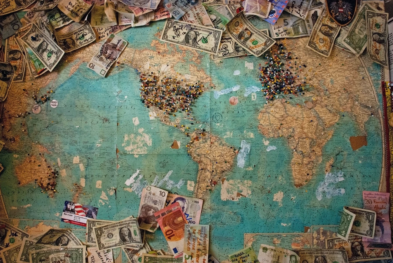 a map of the world with various currencies