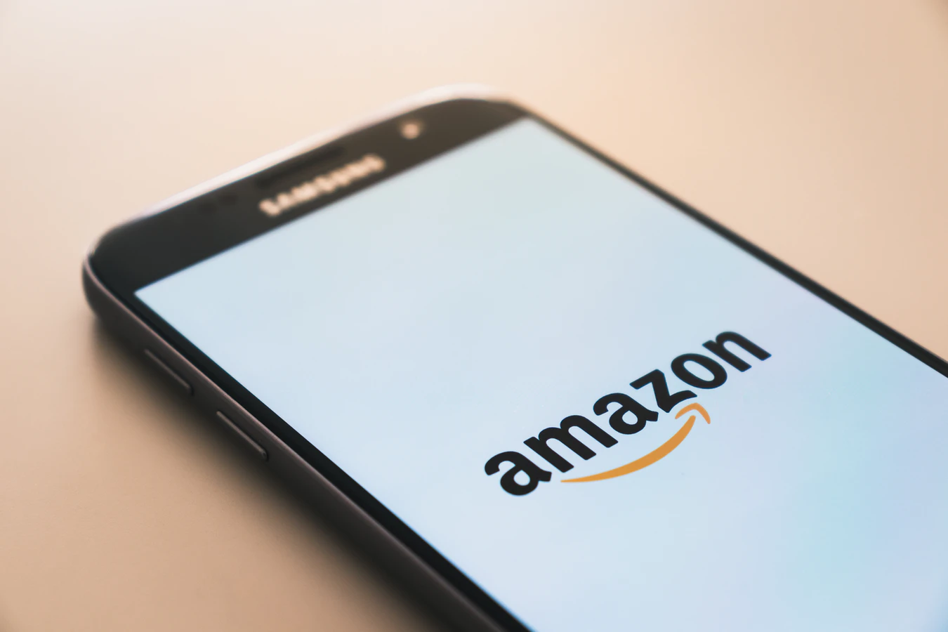 a smartphone with the Amazon introduction screen on it