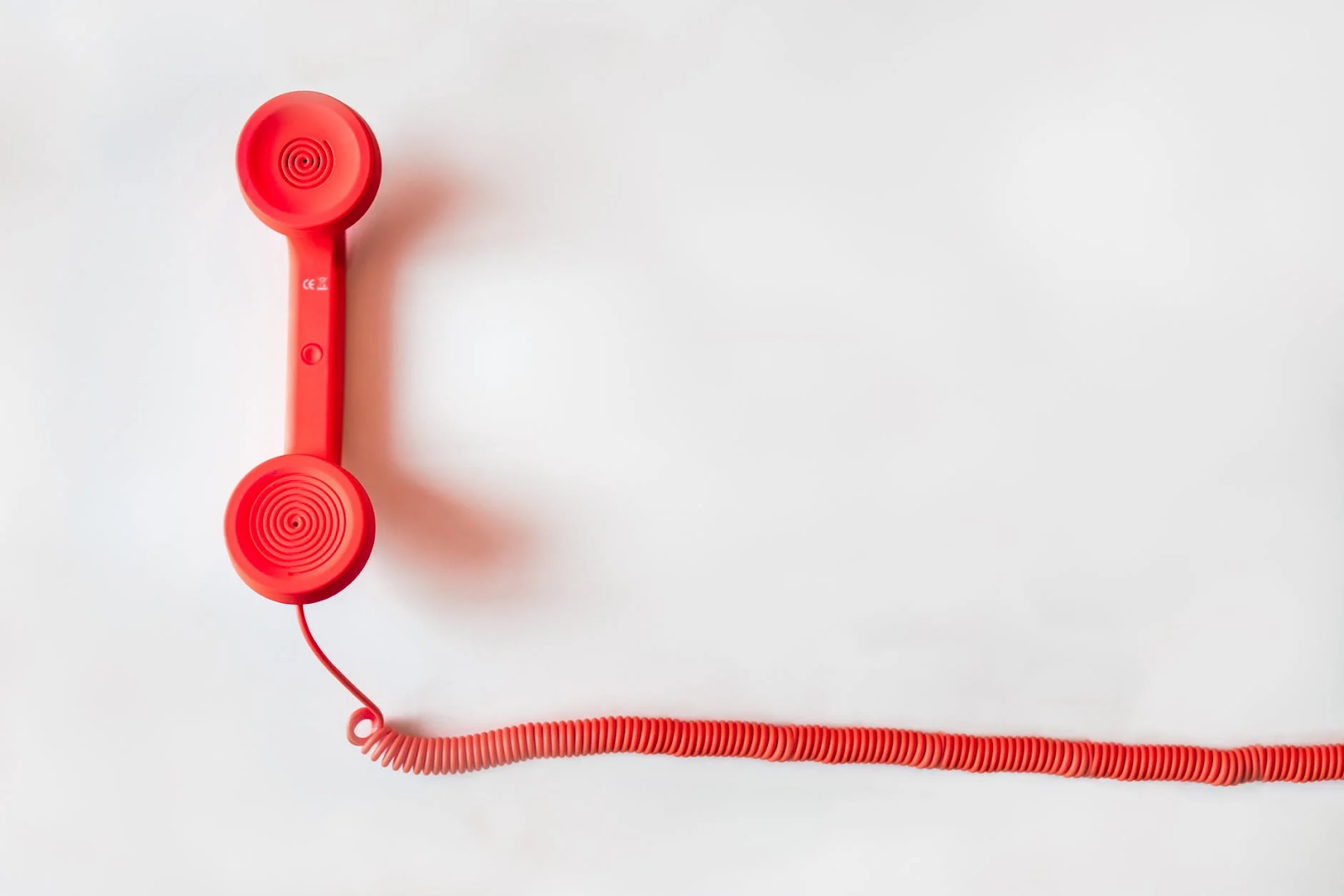 old timey red telephone on a white background
